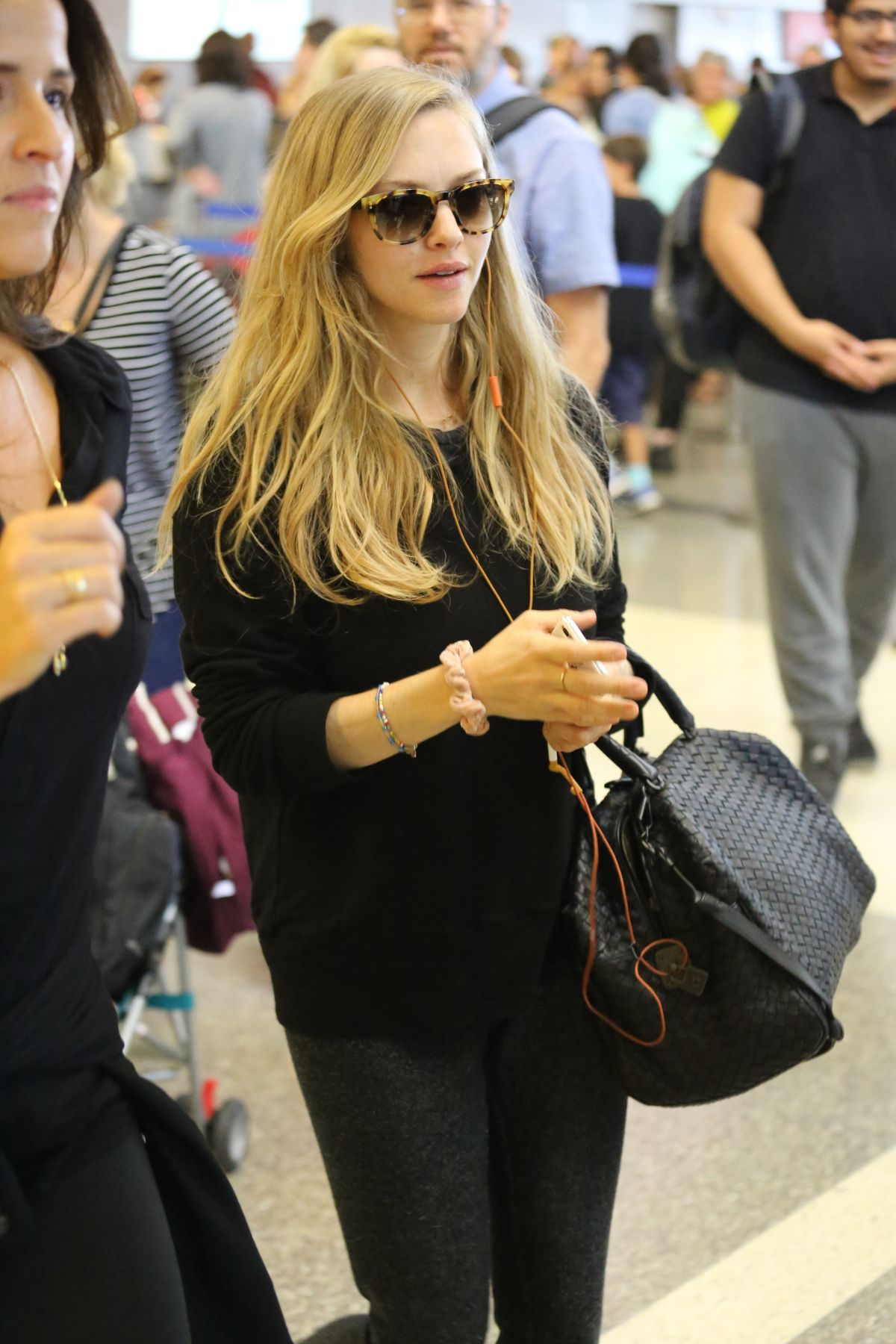 AMANDA SEYFRIED at LAX Airport in Los Angeles 08/29/2017
