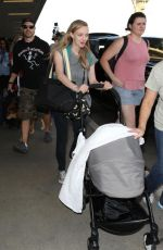 AMANDA SEYFRIED at LAX Airport in Los Angeles 08/22/2017