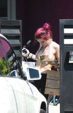 BELLA THORNE in Bikini Top Picks Up Her Delivery from Juice Crafters 08/05/2017