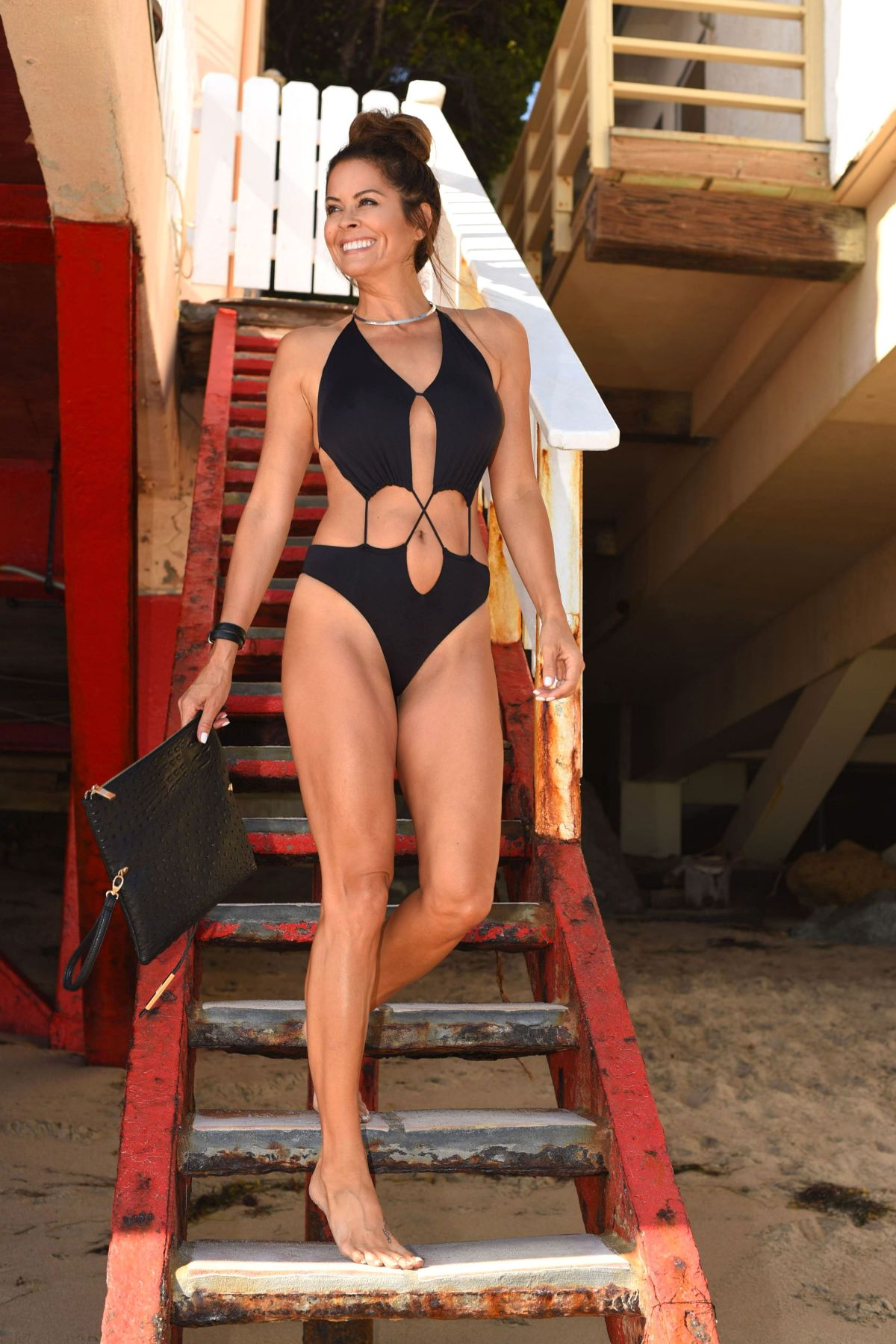 BROOKE BURKE in Swimsuit at Her Beach House in Malibu 08/03/2017