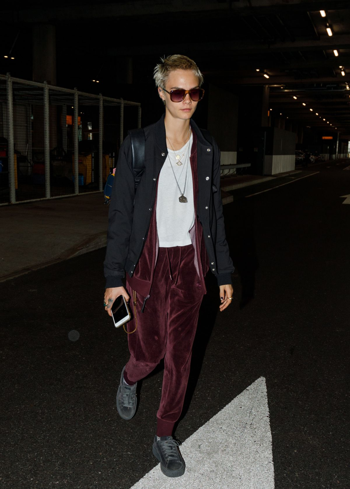CARA DELEVINGNE at Heathrow Airport in London 08/21/2017