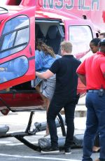 DEMI LOVATO Boarding an Helicopter in New York 08/19/2017