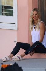 ELYSE KNOWLES on the Set of a Photoshoot for Ugg Shoes at Bondi Beach 08/28/2017