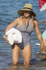 HILARY DUFF in Swimsuit on the Beach in Maui 08/03/2017