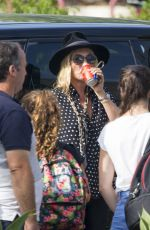 KATE MOSS Waiting for Her Driver at Airport in Ibiza 08/27/2017