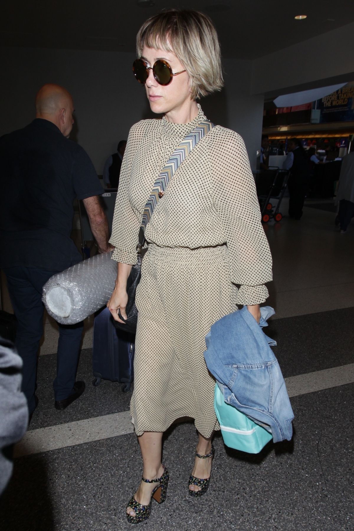 KRISTEN WIIG at Los Angeles International Airport 08/24/2017