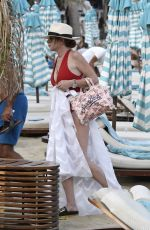 LINDSAY LOHAN in Swimsuit at Nammos Beach in Mykonos 08/21/2017