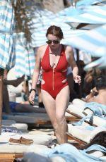 LINDSAY LOHAN in Swimsuit on the Beach in Mykonos 08/28/2017