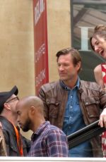 LOUISE BOURGOIN and Aaron Eckhart on the Set of New Series The Romanoffs in Paris 08/10/2017