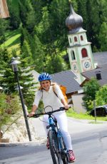 MICHELLE HUNZIKER Out Riding a Bike in San Cassiano in Badia 08/13/2017