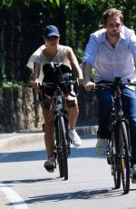 MICHELLE HUNZIKER Ridig a Bicycle Out in Bergamo 08/05/2017