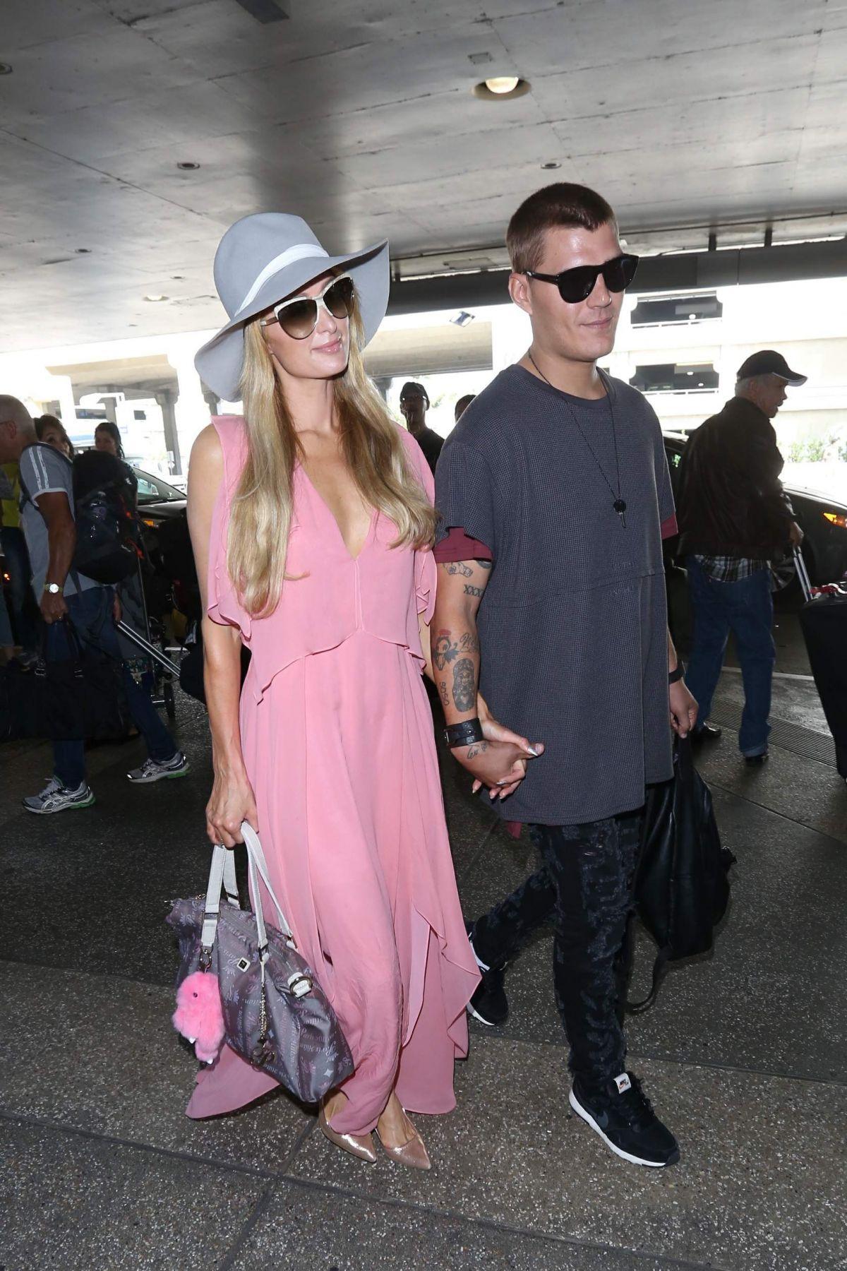 PARIS HILTON and Chris Zlyka at Los Angeles International Airport 08/25/2017