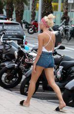 PIXIE LOTT in Denim Shorts Out in Barcelona 08/28/2017