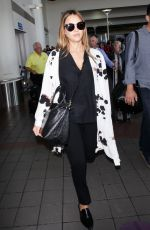 Pregnant JESSICA ALBA at LAX Airport in Los Angeles 08/30/2017