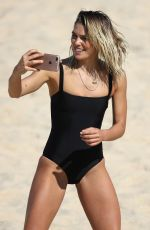 ASHLEY HART in Swimsuit on the Set of at Photoshoot at a Beach in Sydney 09/21/2017