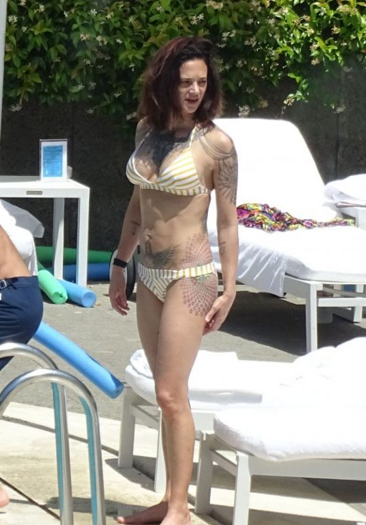 ASIA ARGENTO in Bikini and Anthony Bourdain at a Pool in Rome 09/20/2017