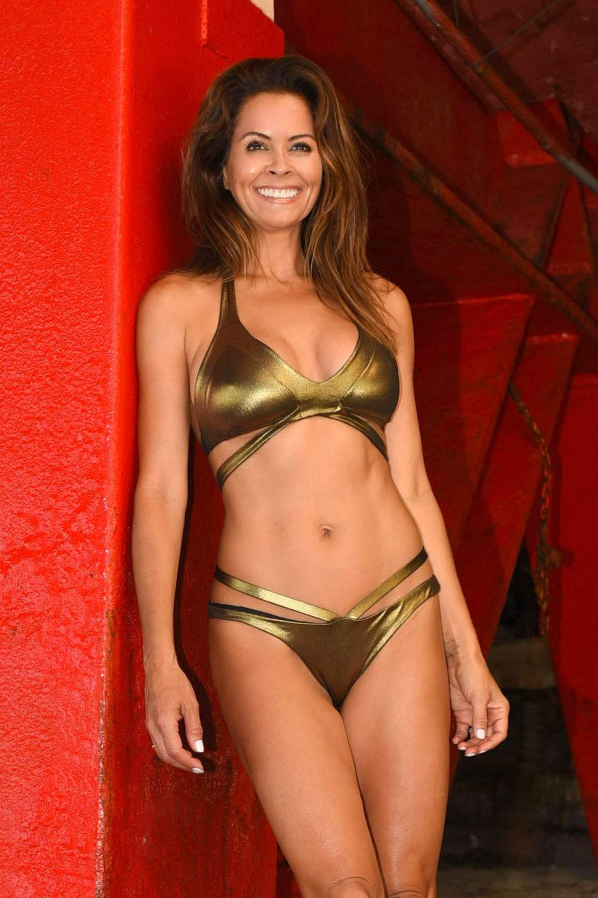 BROOKE BURKE in a Gold Bikini at a Beach in Malibu 08/30/2017