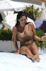 CASEY BATCHELOR and FRANKIE ESSEX in Swimsuits at a Pool in Spain 09/18/2017
