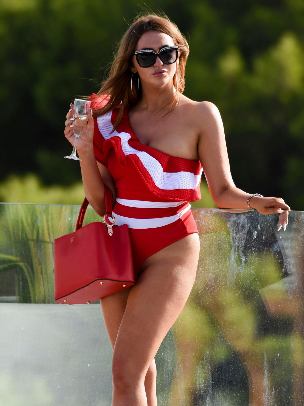 CHARLOTTE DAWSON in Swimsuit on the Set of a Photoshoot in Tenerife 09/07/2017