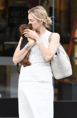 KELLY RUTHERFORD Out with Her Dog in Los Angeles 09/25/2017