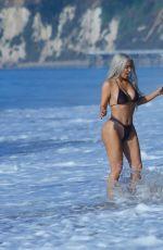 KIM KARDASHIAN in Bikini at a Beach in Malibu 09/20/2017