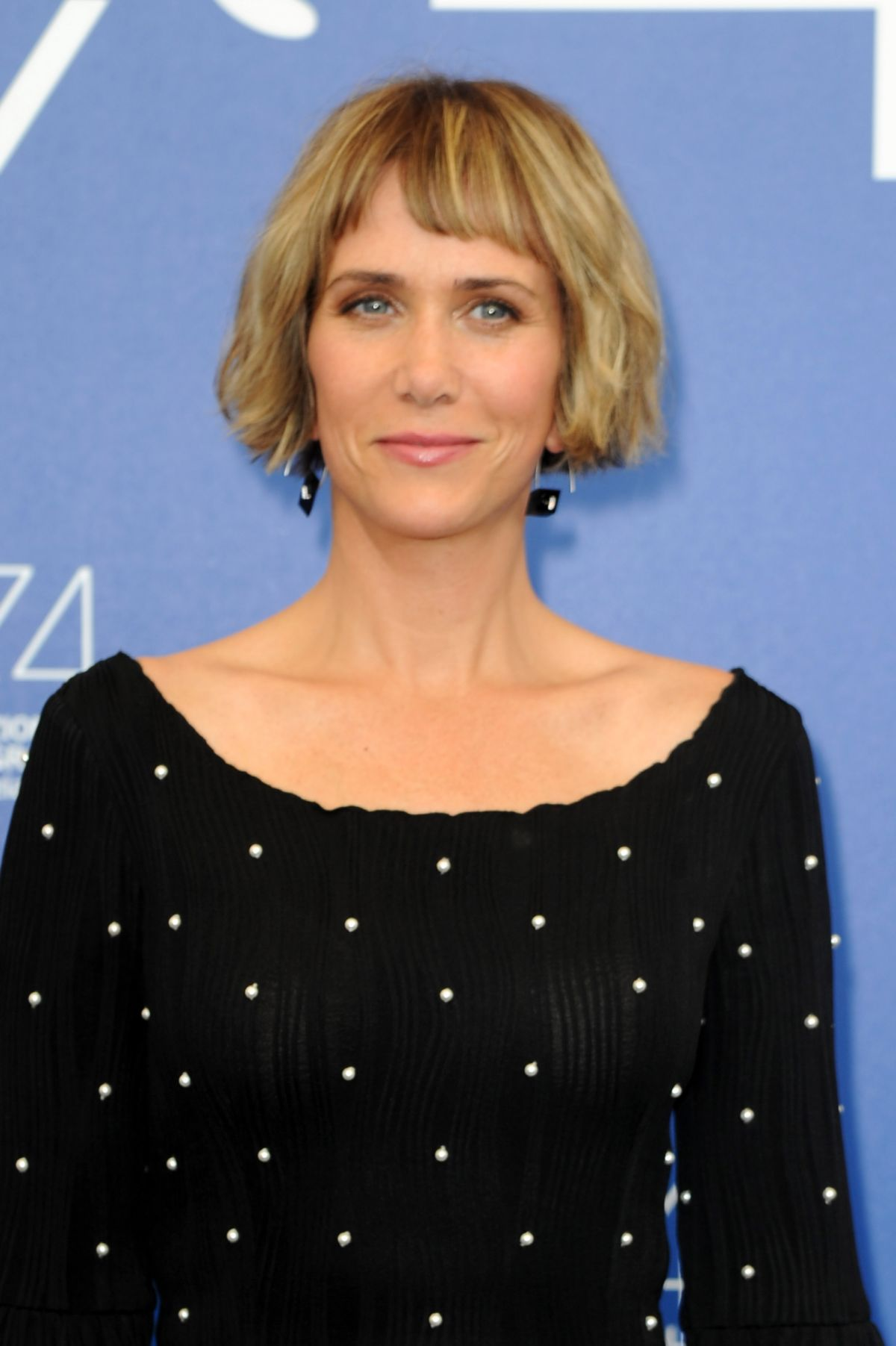 KRISTEN WIIG at Downsizing Photocall at Venice International Film Festival 08/30/2017