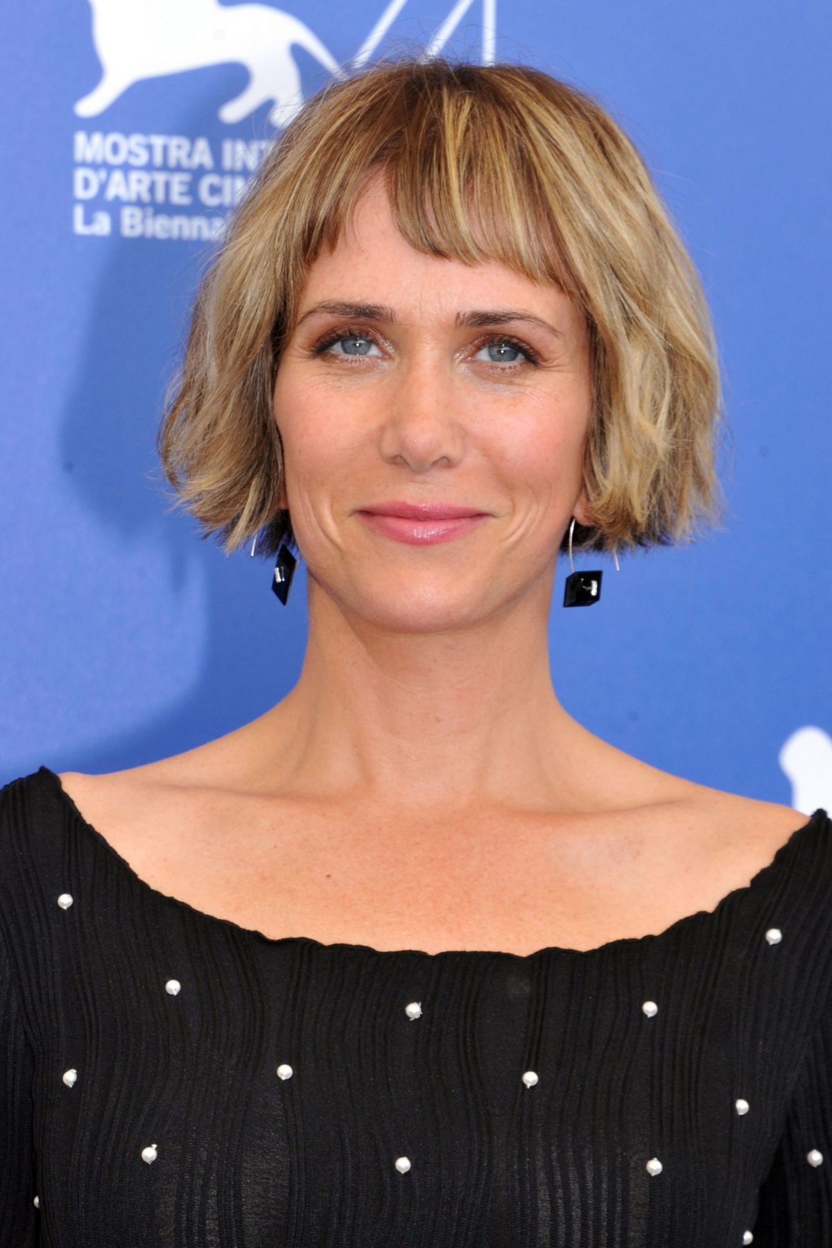 KRISTEN WIIG at Downsizing Photocall at Venice ...