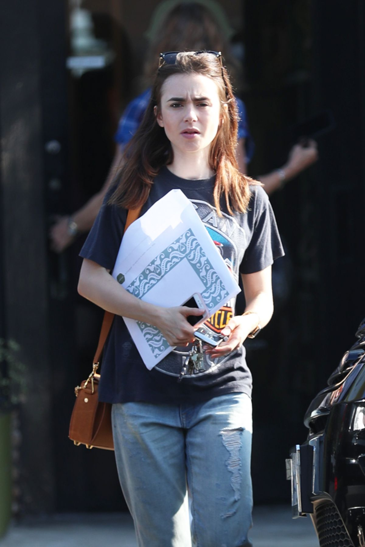 LILY COLLINS Out Shopping in Los Angeles 09/20/2017