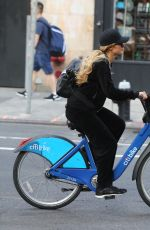 PARIS HILTON and Chris Zylka Riding Bicycles Out in New York 09/17/2017