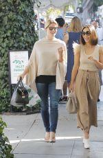 ASHLEY GREENE and CARA SANTANA at Ivy in West Hollywood 10/12/2017