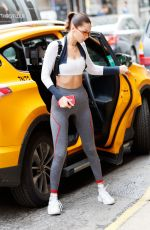 BELLA HADID in Tights Getting Out of a Cab in New York 10/12/2017