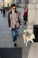 CARA DELEVINGNE with Her Dog Arrives at Hotel in London 10/05/2017