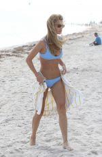 CAROLINE LOWE in Bikini at a Beach in Miami 10/22/2017