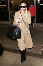 CHRISSY TEIGEN at LAX Airport in Los Angeles 10/06/2017