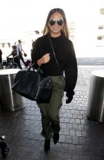 CHRISSY TEIGEN at Los Angeles International Airport 10/02/2017