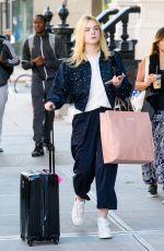 ELLE FANNING Arrives Back in New York 10/04/2017