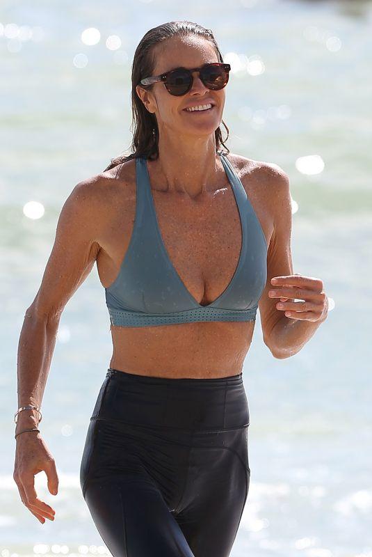 ELLE MACPHERSON in Bikini Top and Leggings at a Beach in Miami 10/13/2017