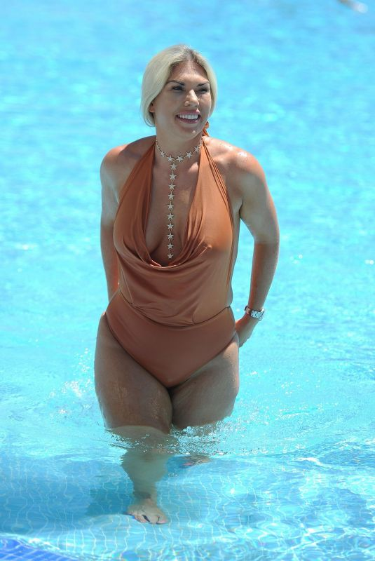 FRANKIE ESSEX in Swimsuit at a Pool in Marbella 10/09/2017