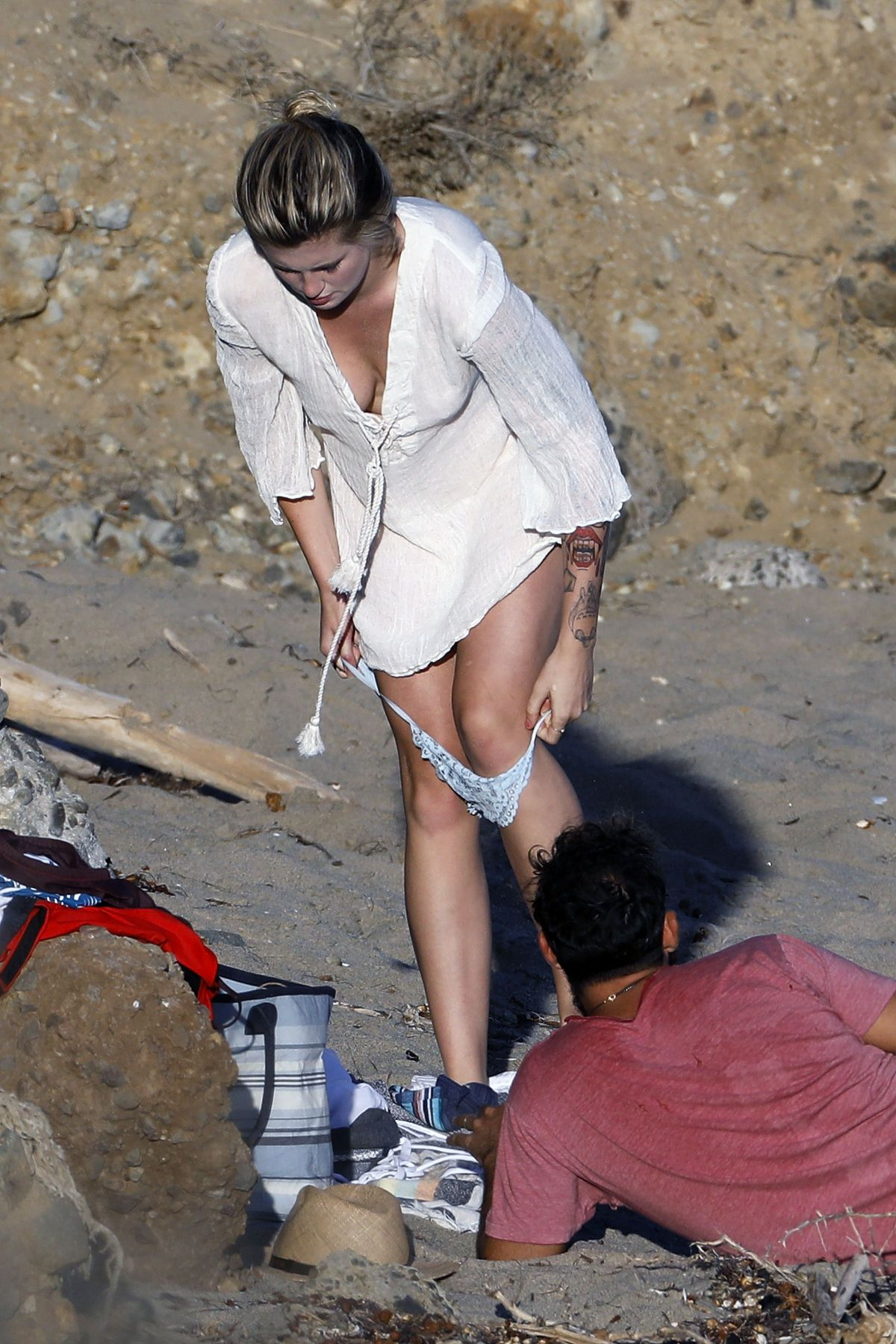 IRELAND BALDWIN on the Set of a Photoshoot at a Beach in