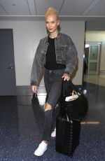 KARLIE KLOSS in Dark Denim at LAX Airport in Los Angeles 10/15/2017