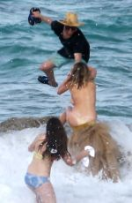 KATE UPTON Falls off Rock on the Set of SI 2018 Swimsuit Issue in Aruba 10/11/2017