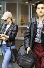 LILI REINHART and Cole Sprouse at Airport in Vancouver 10/10/2017