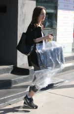 LILY COLLINS Getting Up Her Dry Cleaning in West Hollywood 10/11/2017