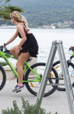 LILY JAMES Out Riding a Bike in Croatia 10/06/2017