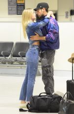 MEGAN BLAKE IRWIN and Nicolo Knows Kissing at Sydney Airport 10/19/2017