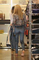 MICHELLE HUNZIKER Out Shopping in Milan 10/23/2017