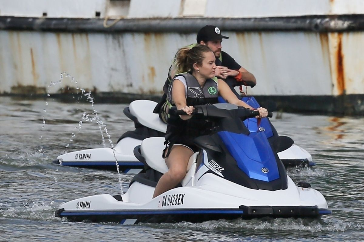 MILEY CYRUS and Liam Hemsworth at Tybee Island in Georgia ...
