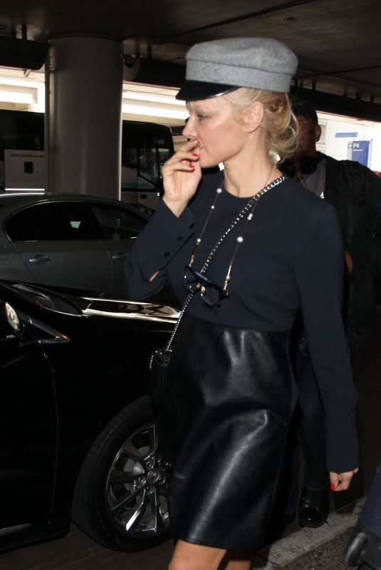 PAMELA ANDERSON at Los Angeles International Airport 10/04/2017