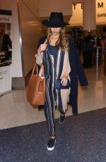 Pregnant JESSICA ALBA at Los Angeles International Airport 10/27/2017