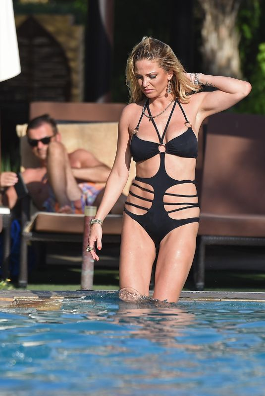 SARAH HARDING in Bikini at a Beach in Dubai 10/16/2017